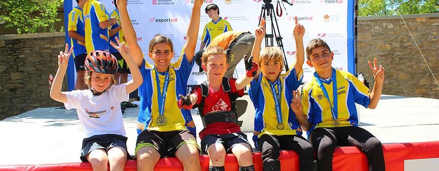 ESCOLA DE CAMPIONS. A la foto Gemma, Joan i Alan Campions de Catalunya de Trial 2015